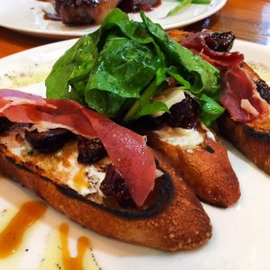 Bruschetta with 800-day aged prosciutto, figs, goat cheese & burnt honey