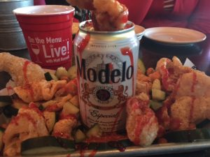 The Mexi-CAN, with fried pork rinds, shrimp, Asian peanuts, veggies, Tajin, Chamoy, and a cold Modelo!